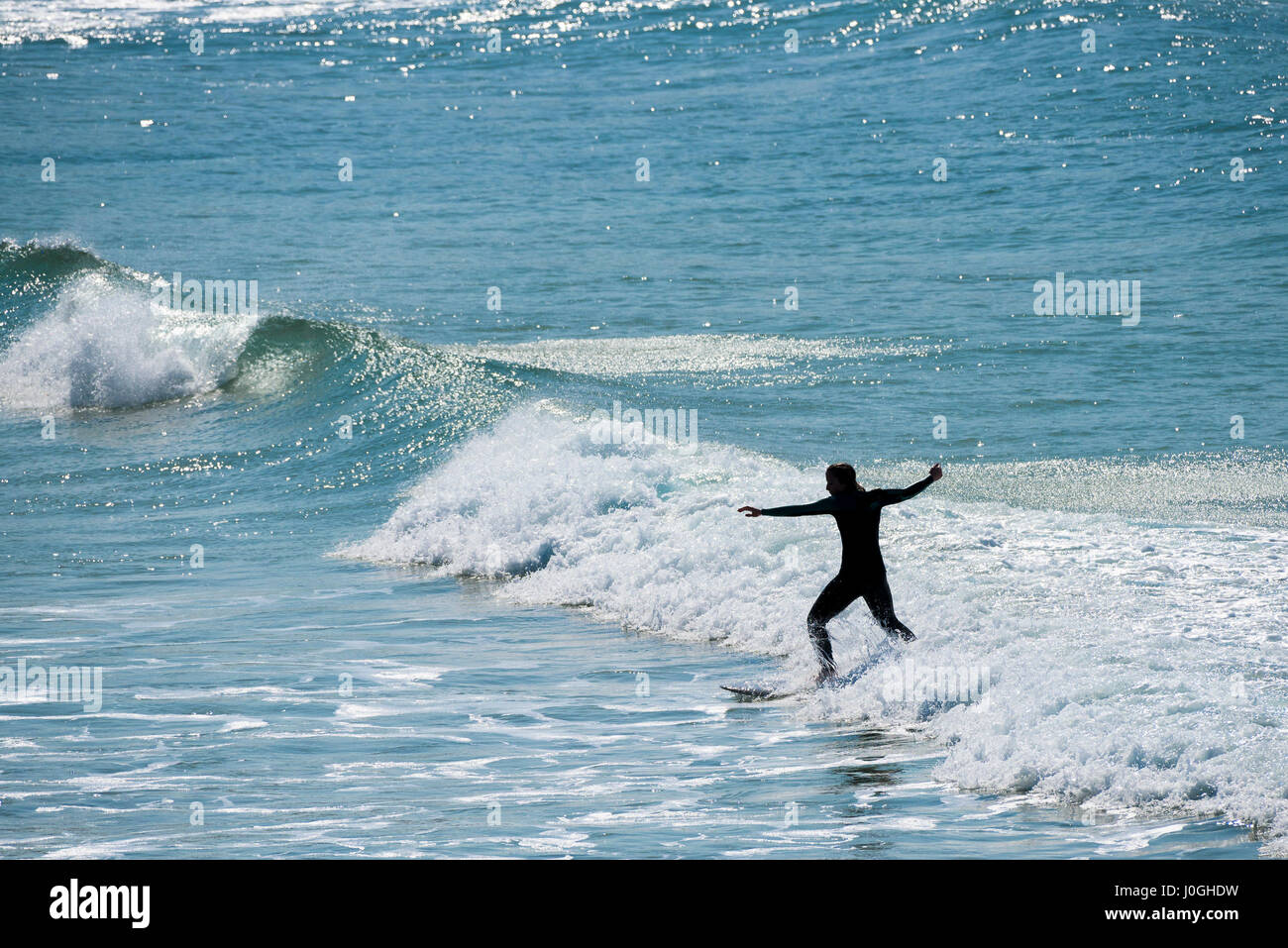 Surfer UK Sea Surfing Longboard Water Hobby Leisure activity Balance Newquay Cornwall - Stock Image