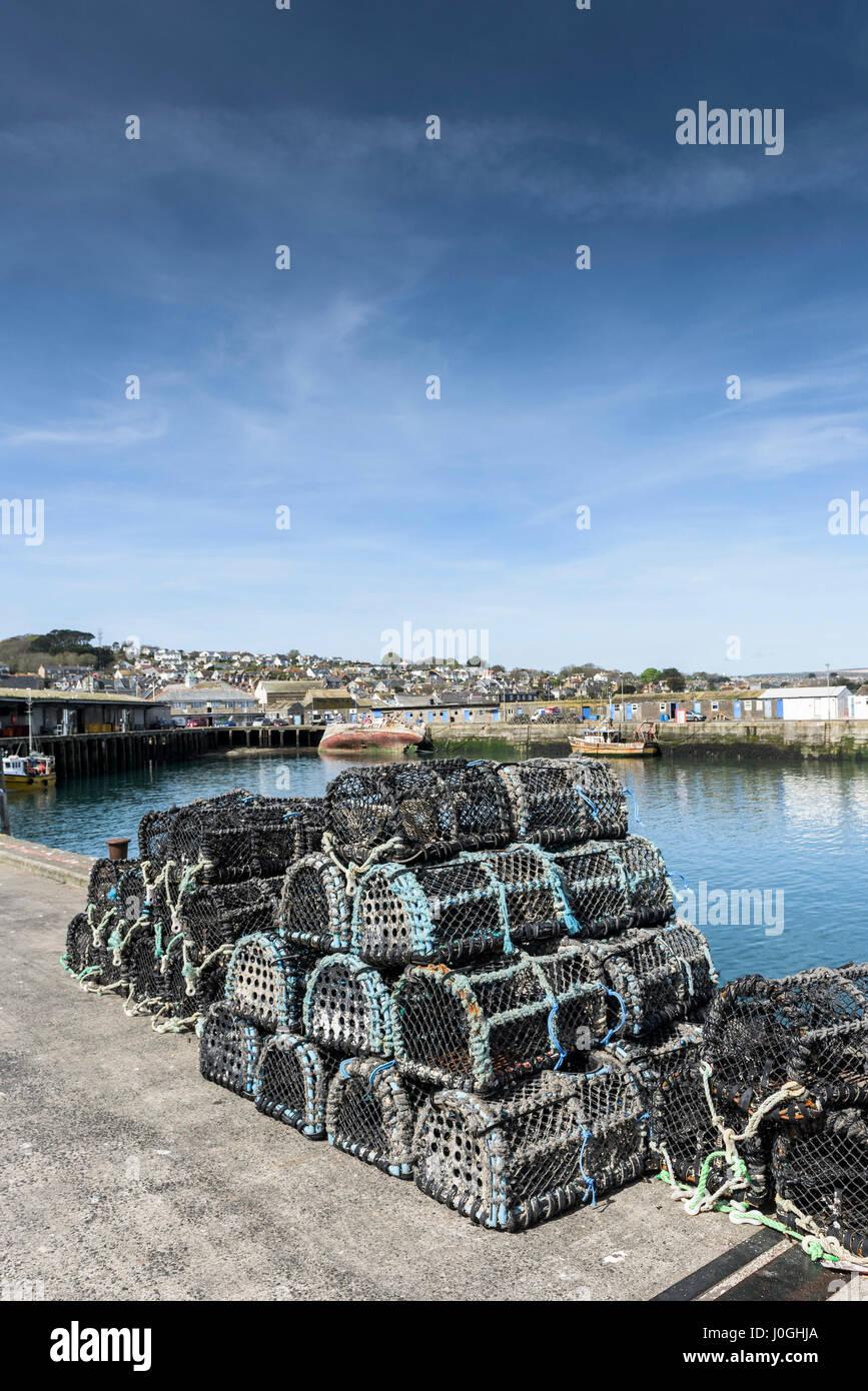 Newlyn Fishing Port Lobster pots Quayside Harbour Harbor Fishing industry Coast Coastal scene Cornwall - Stock Image