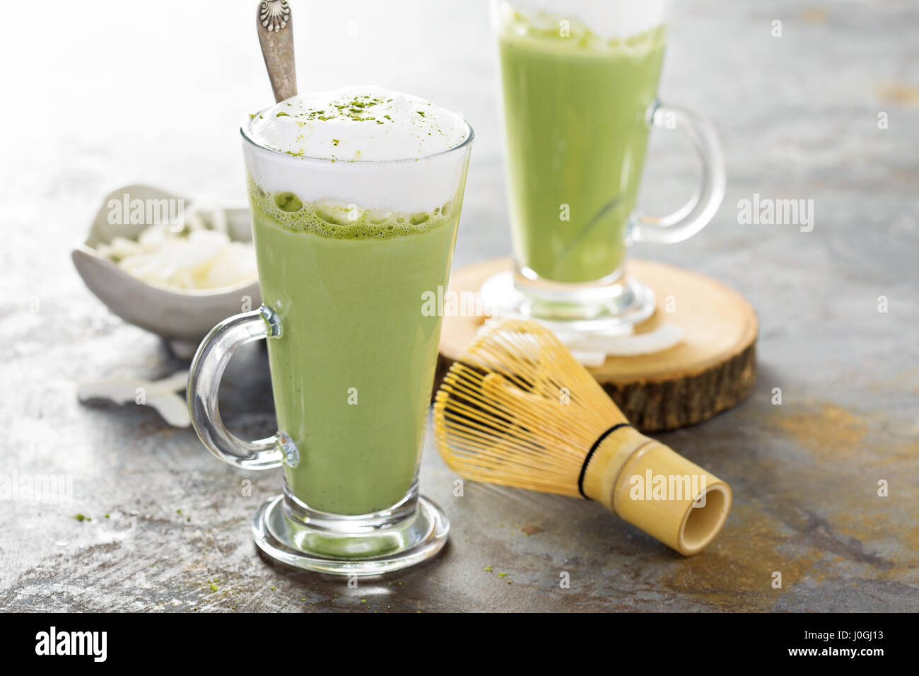 Matcha coconut latte in tall glasses - Stock Image