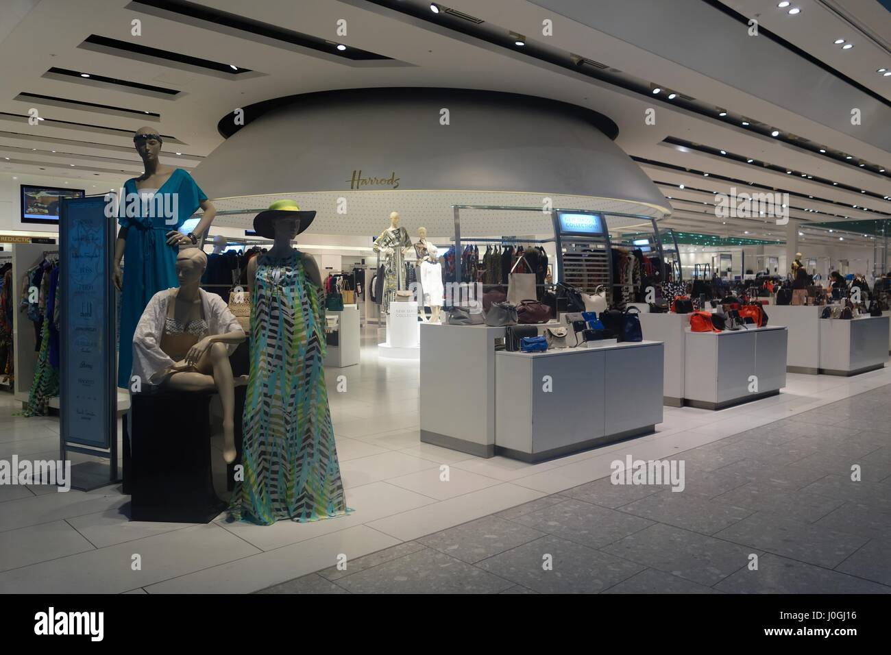 Open plan layout of the Harrods store in terminal five London Heathrow international airport, England, UK - Stock Image