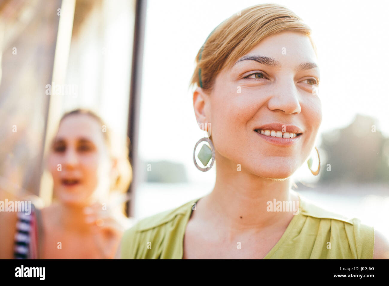 portrait of a young woman smiling in Novi Sad, Serbia - Stock Image