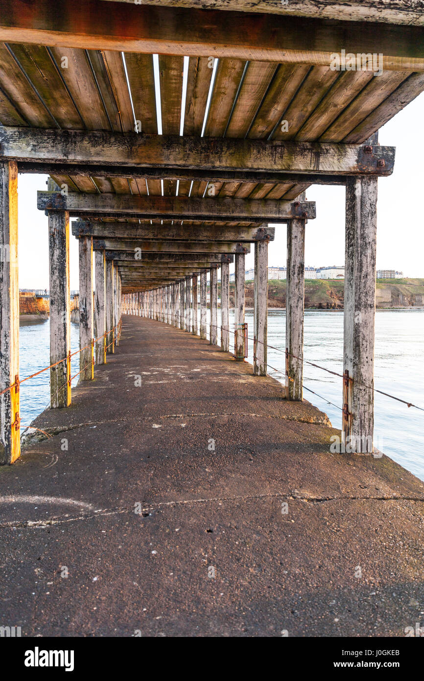 Under Whitby Pier Underneath Whitby pier supports wooden structure supporting Whitby pier Whitby harbour Whitby - Stock Image