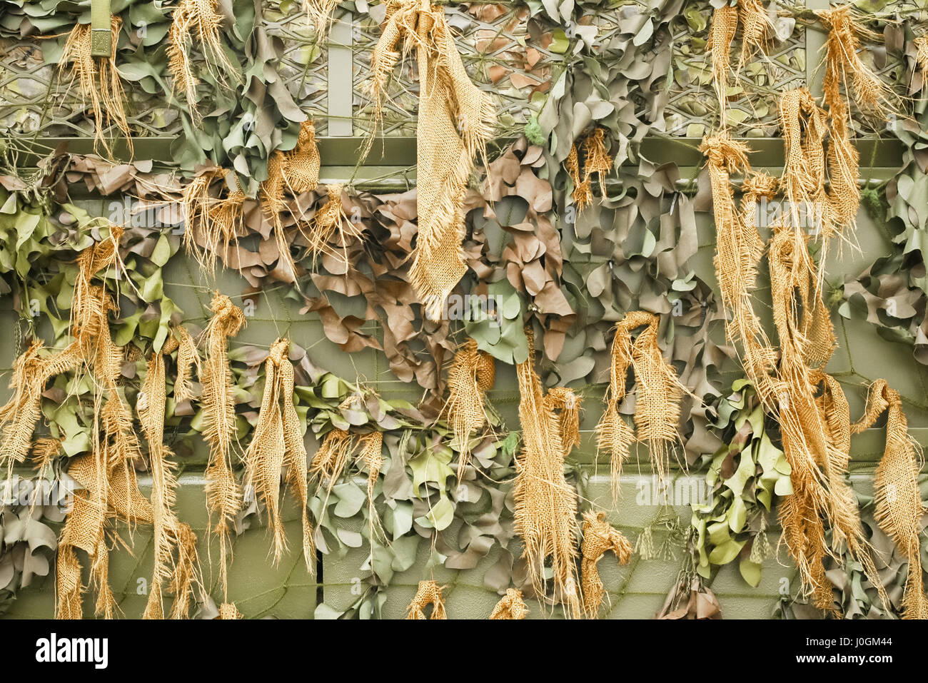 background of military camouflage netting - Stock Image
