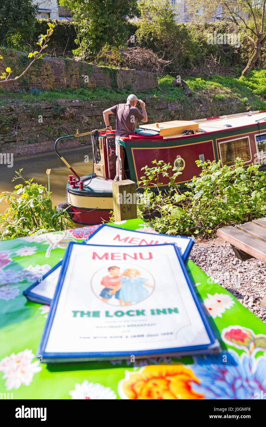 Lock Inn café menus with views of narrow boats passing by on the Kennet and Avon canal at Bradford on Avon, - Stock Image