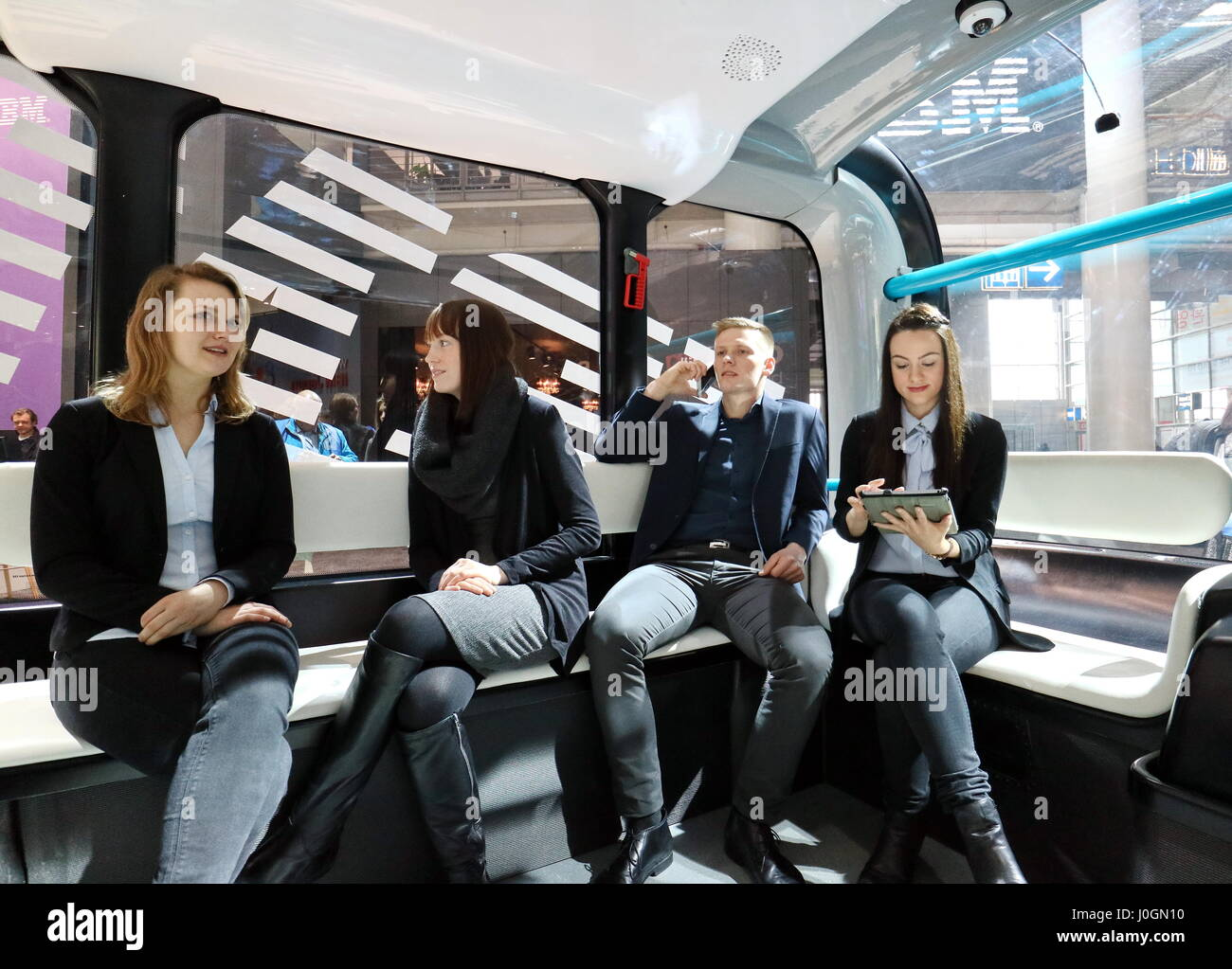 """Hanover, Germany. 19th March, 2017. Passengers self-driving electric minibus """"Olli"""", developed by Local Motors in Stock Photo"""