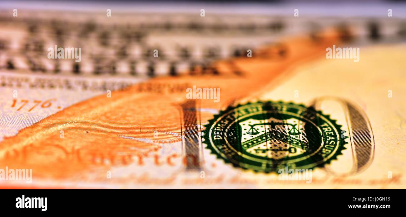 Macro shot on the 100 USD bill with narrow field of view and the balance partially in focus - Stock Image