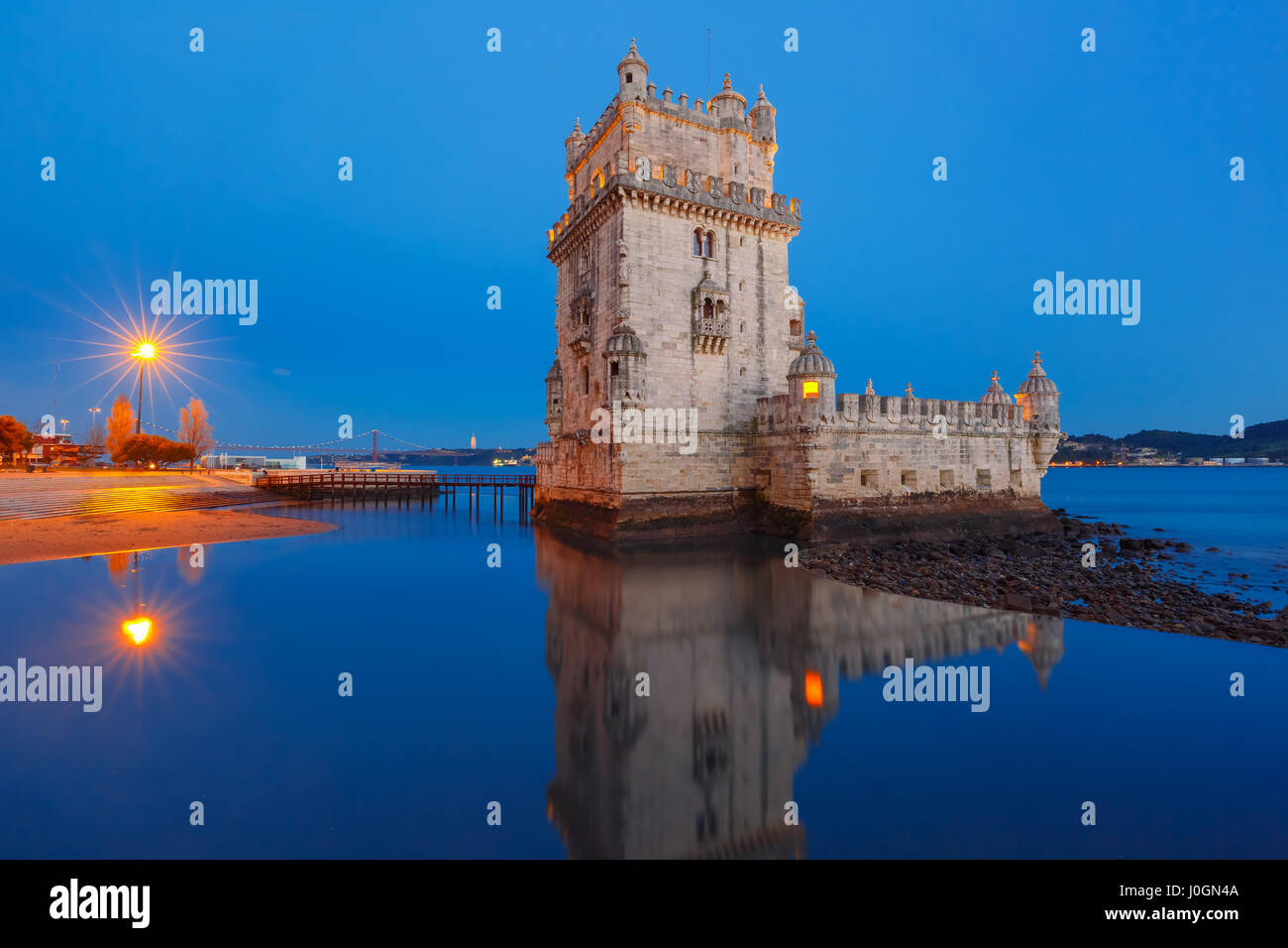 Belem Tower or Tower of St Vincent on the bank of the Tagus River during evening blue hour, Lisbon, Portugal Stock Photo
