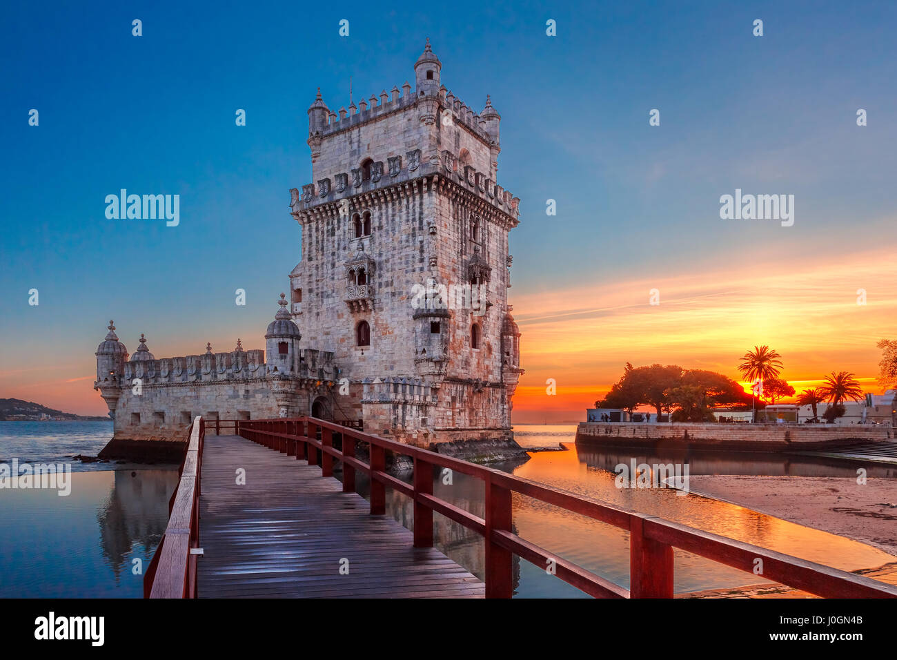 Belem Tower or Tower of St Vincent on the bank of the Tagus River at scenic sunset, Lisbon, Portugal - Stock Image
