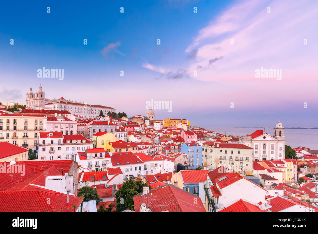 View of Alfama, the oldest district of the Old Town, with Monastery of Sao Vicente de Fora, Church of Saint Stephen - Stock Image