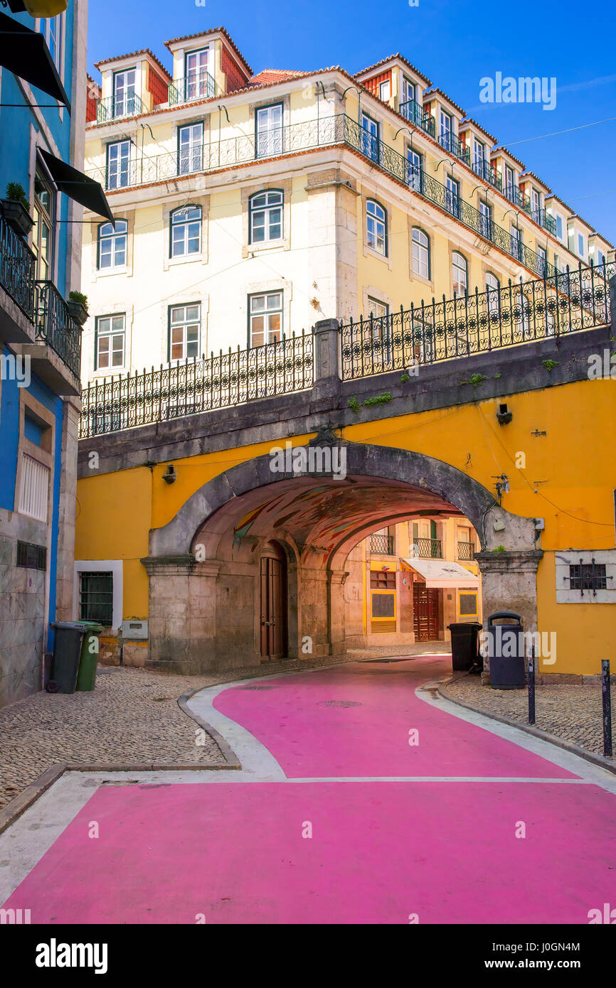 The famous pedestrian Pink street of Rua Nova do Carvalho in the Cais do Sodre area of Lisbon, Portugal - Stock Image