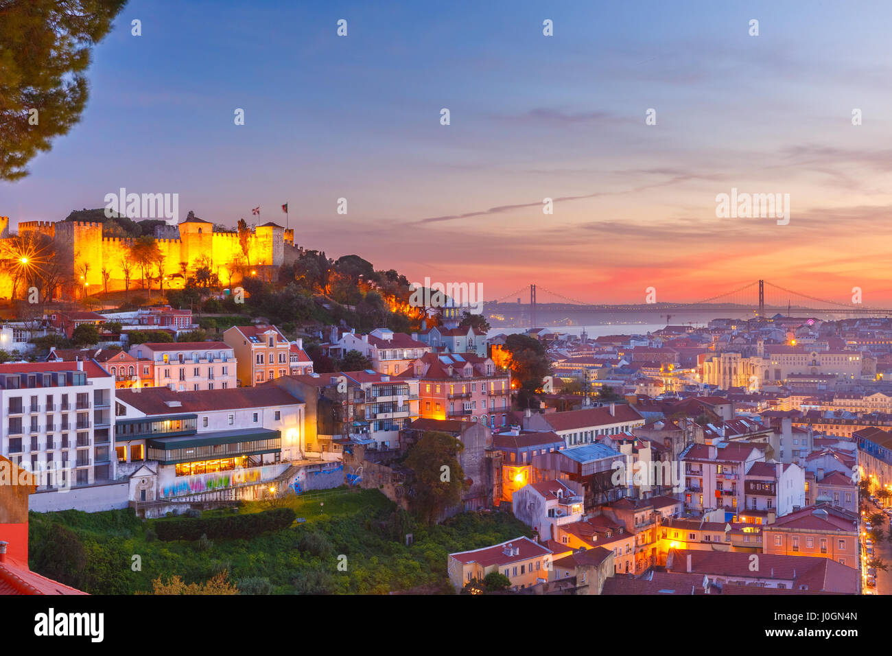 The Castle of Sao Jorge, the historical centre of Lisbon, Tagus River and 25 de Abril Bridge at scenic sunset, Lisbon, - Stock Image