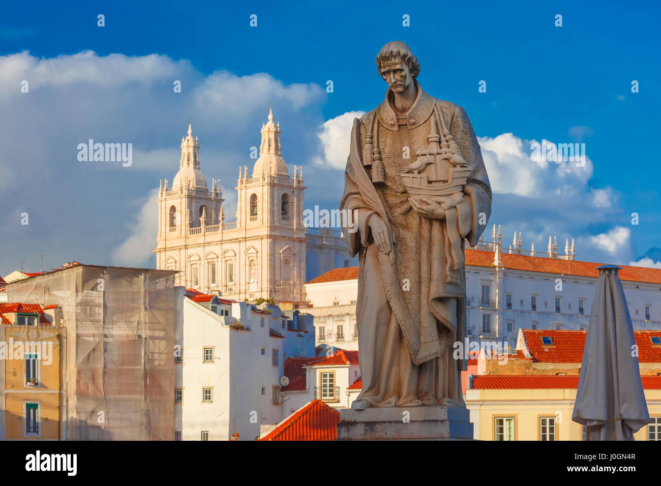 Statue of Saint Vincent, the patron saint of Lisbon, in Alfama, Lisbon, Portugal. Monastery of Sao Vicente de Fora - Stock Image