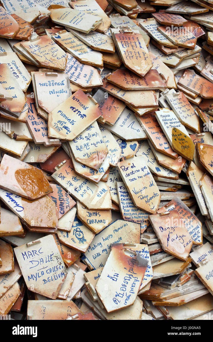 Messages Written On Roof Tiles At A Thai Temple - Stock Image