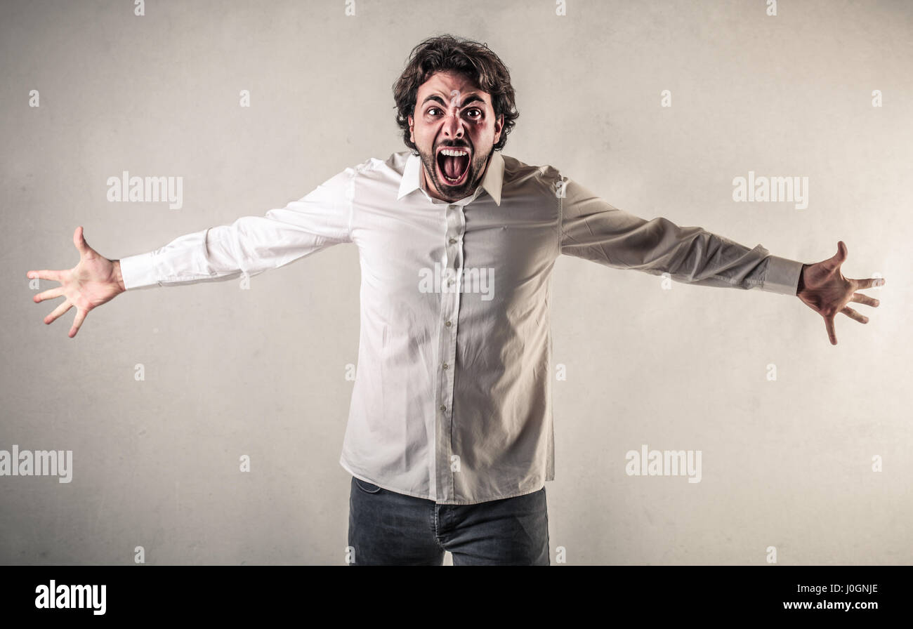 Angry man yelling - Stock Image