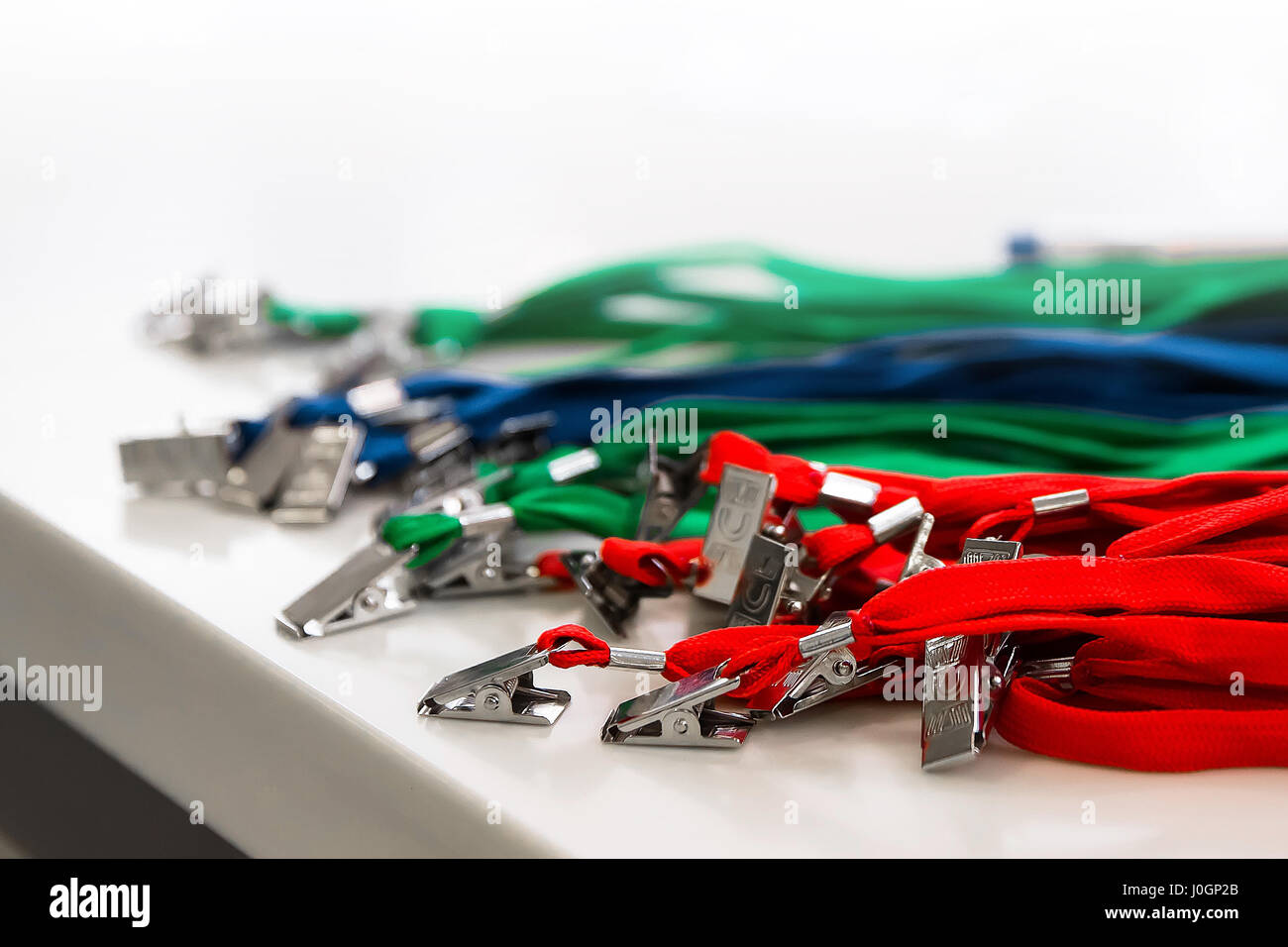 Colored lanyard for id cards and badges on white background - Stock Image