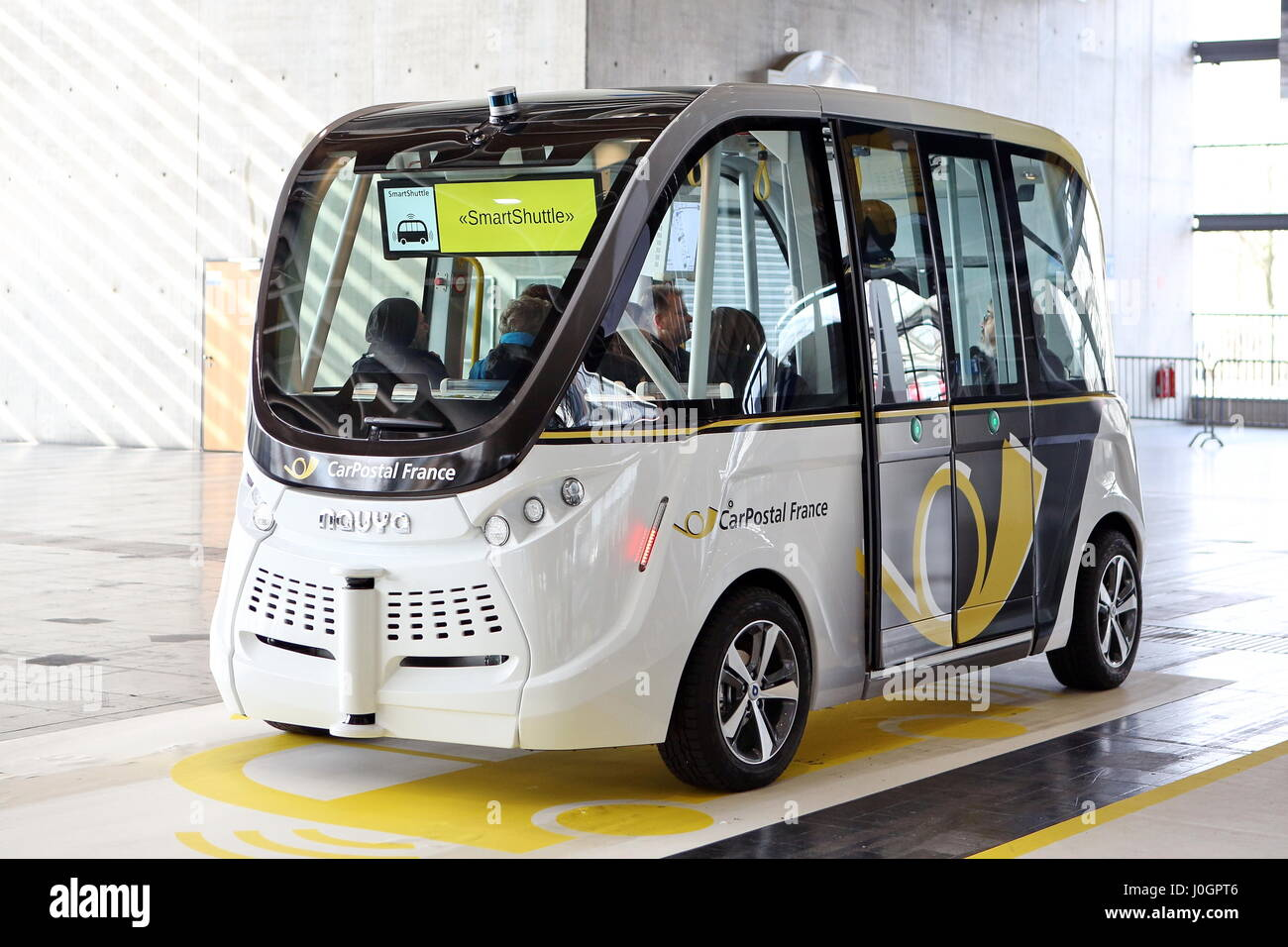 Hanover, Germany. 21th March, 2017. self-driving electric minibus by PostAuto Switzerland (here its french subsidiary Stock Photo