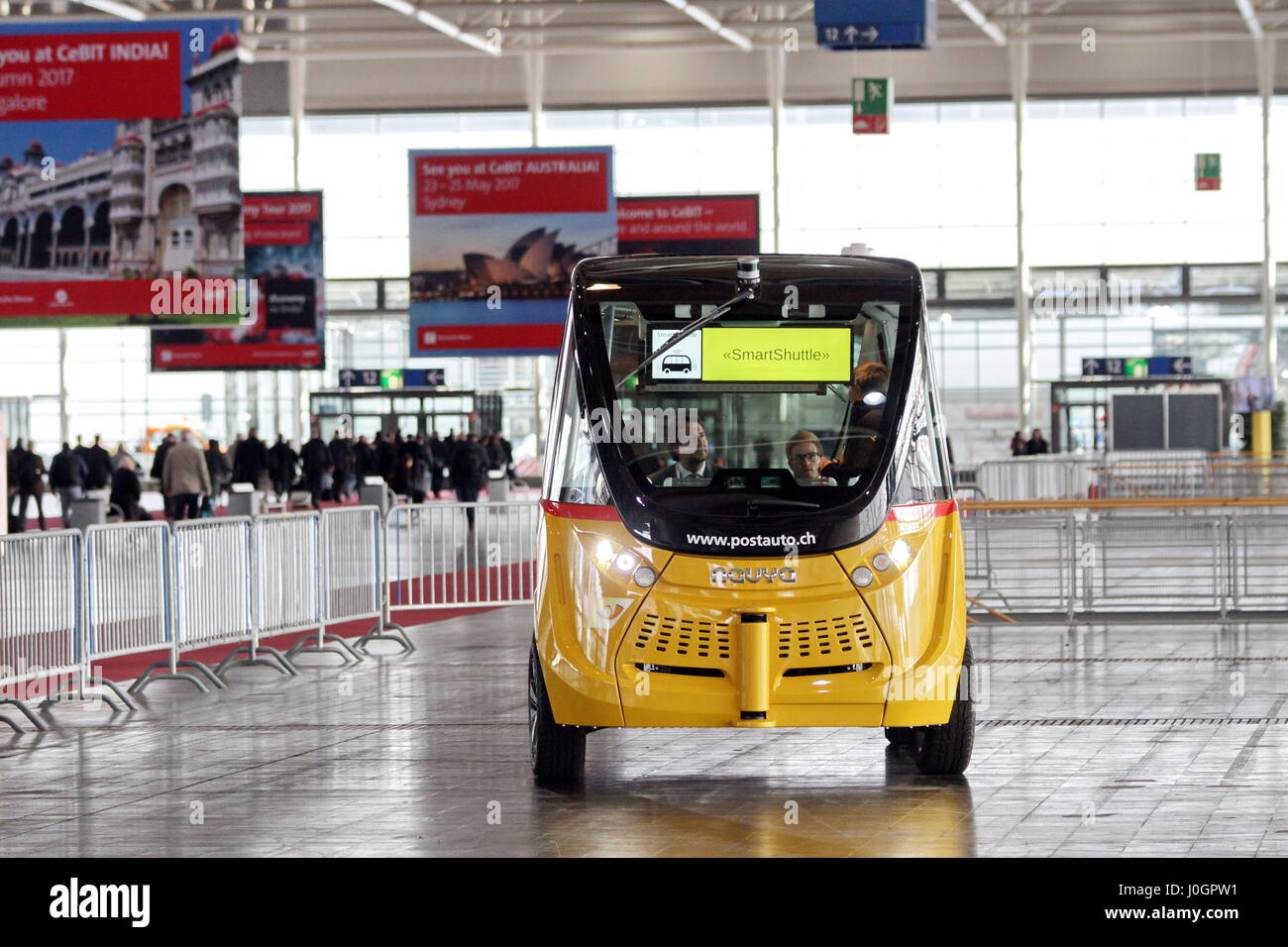 Hanover, Germany. 21th March, 2017. self-driving electric minibus by PostAuto Switzerland invides fair visitors Stock Photo