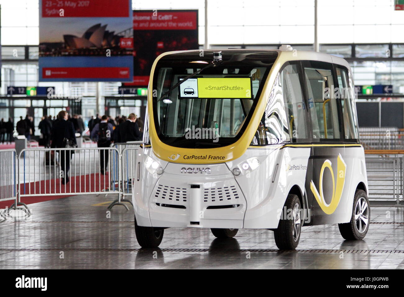 Hanover, Germany. 21th March, 2017. self-driving electric minibus by PostAuto Switzerland (here its french subsidiary - Stock Image