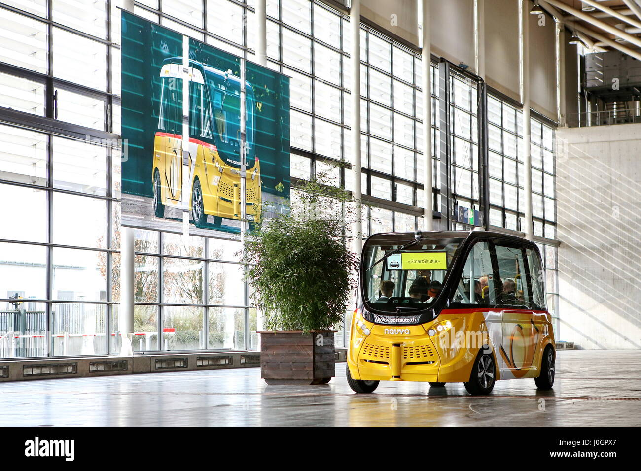 Hanover, Germany. 21th March, 2017. self-driving electric minibus by PostAuto Switzerland invides fair visitors - Stock Image