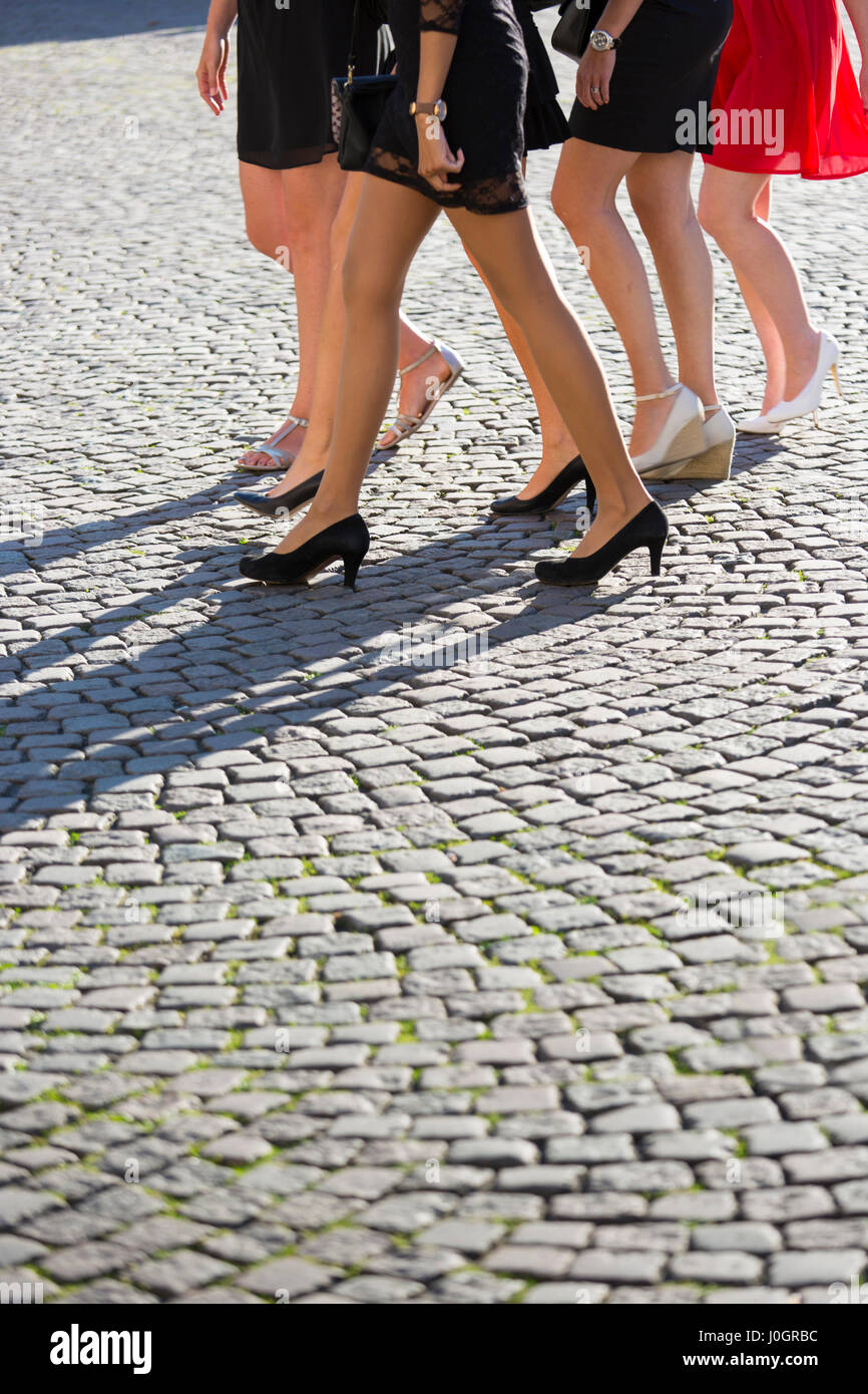 Girls' night out - detail of legs, high heels and short skirts ( miniskirt)  of a group of young ladies in likely - Stock Image