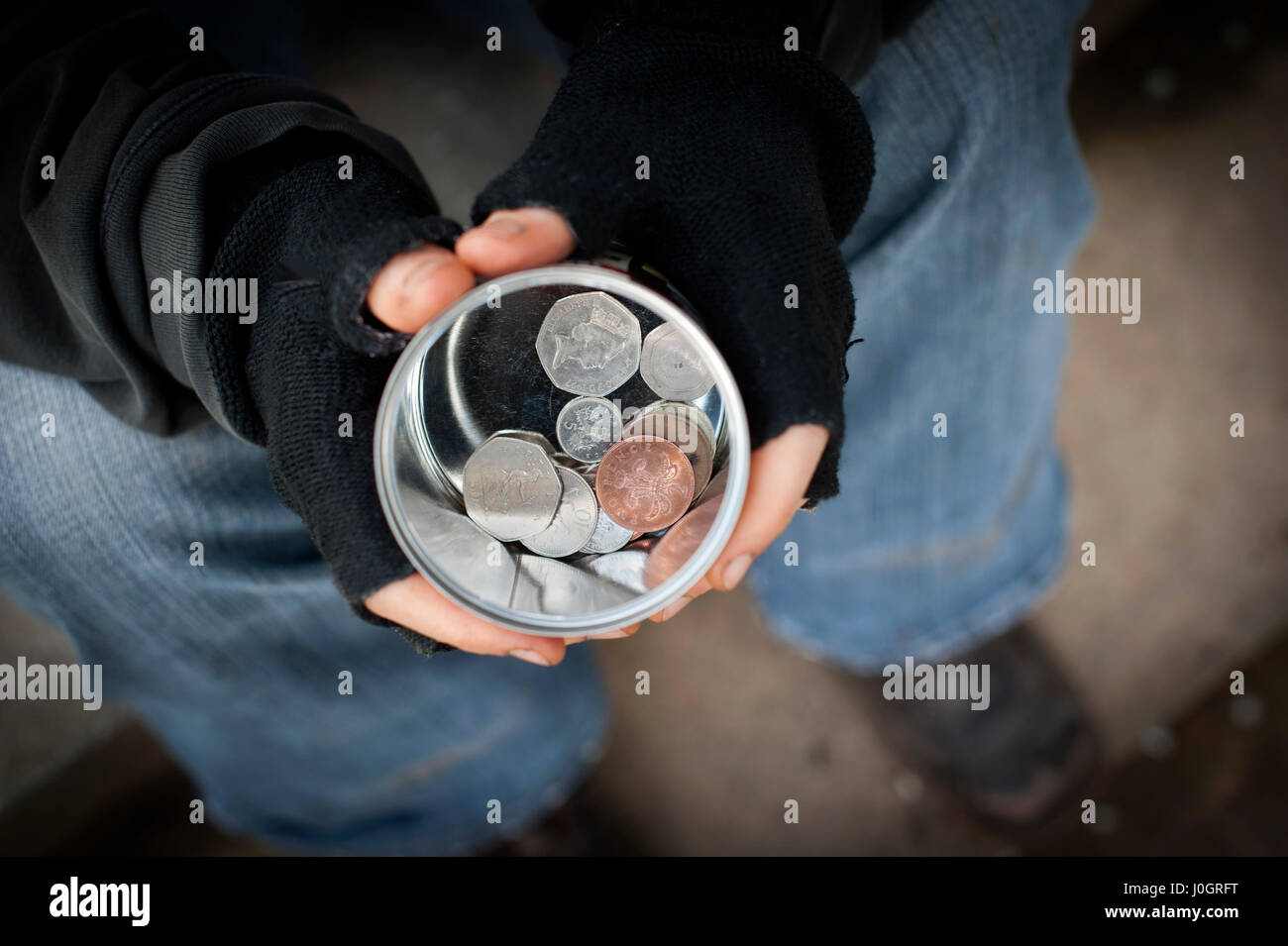 Begging on the streets. - Stock Image