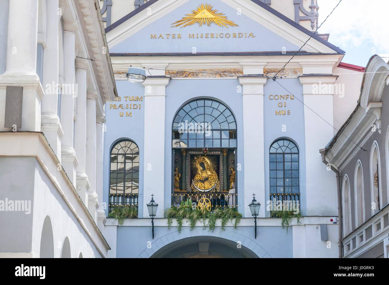 The chapel of Our Lady of the Gate of Dawn is in the middle behind the glass window. Vilnius, Lithuania. - Stock Image