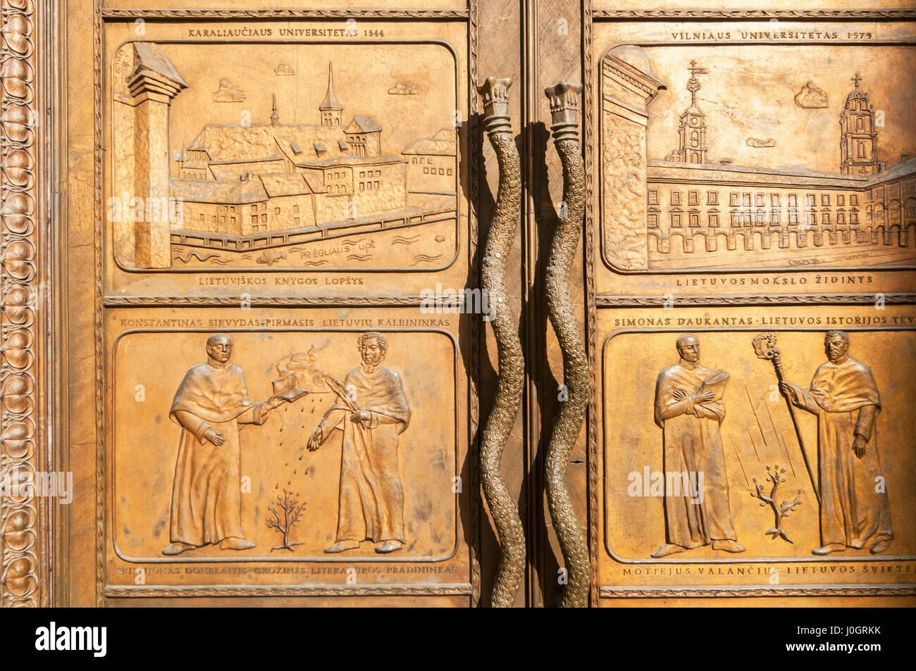 A bronze door at the Vilnius University library commemorates the first Lithuanian book - Stock Image