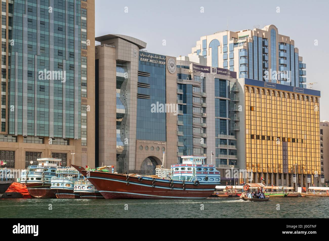 wooden office buildings. Old Wooden Dhows Moored On Dubai Creek With Modern Office Buildings In The Background, City, United Arab Emirates C