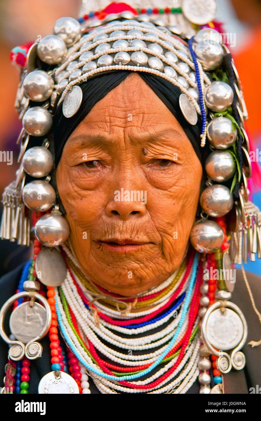 Akha hill tribe woman with traditional headdress, Chiang Mai Province, Thailand. - Stock Image