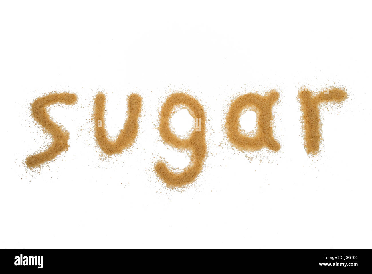 word sugar written with brown granulated sugar isolated - Stock Image