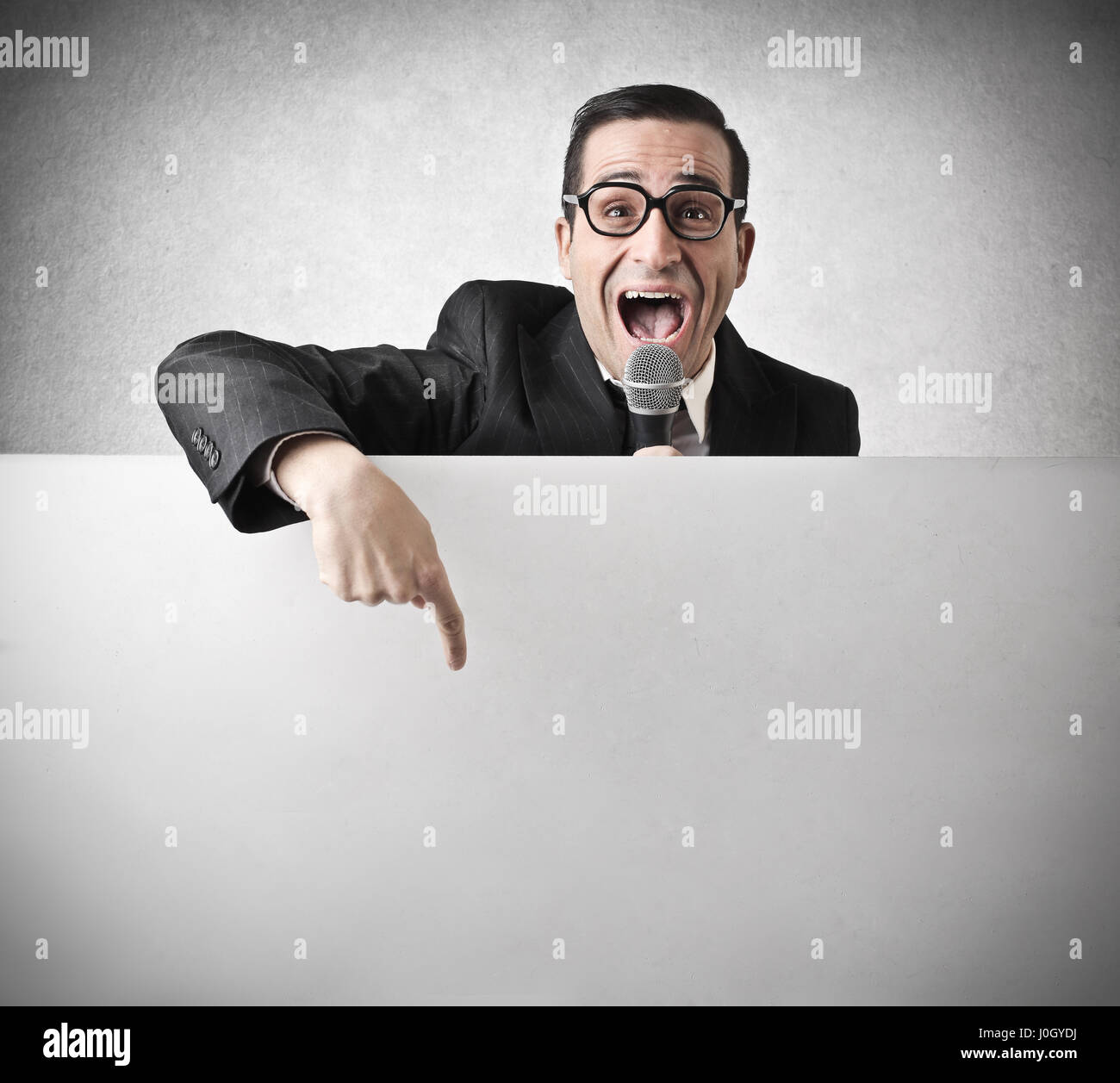 Businessman pointing at empty board - Stock Image