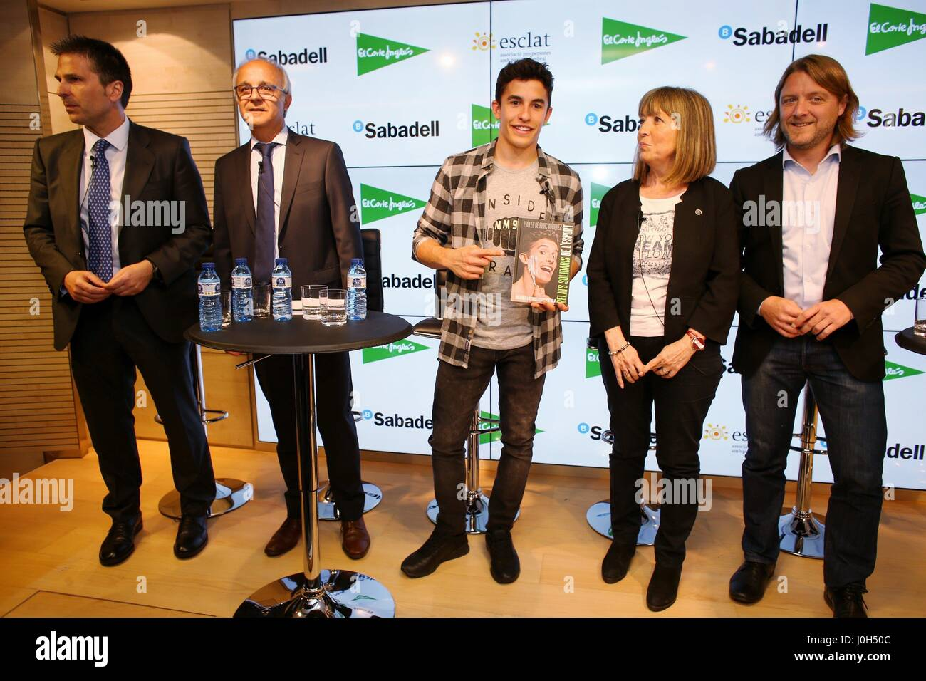Barcelona, Spain. 13th Apr, 2017. Spanish MotoGP rider Marc Marquez (C) poses with other personalities during the - Stock Image