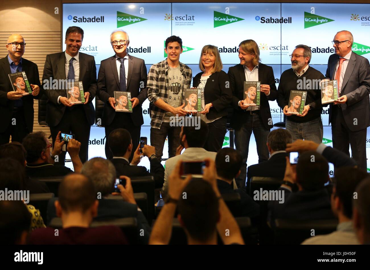 Barcelona, Spain. 13th Apr, 2017. Spanish MotoGP rider Marc Marquez (C-L) poses with other personalities during - Stock Image