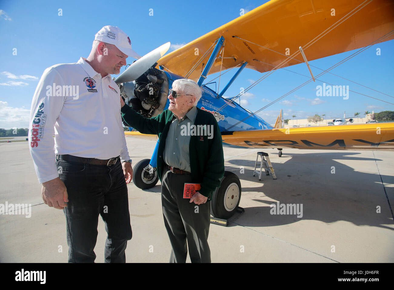 Florida, USA. 13th Apr, 2017. Duane Webster, age 95, talks with Darryl Fisher (Founder - President - Pilot of Ageless - Stock Image