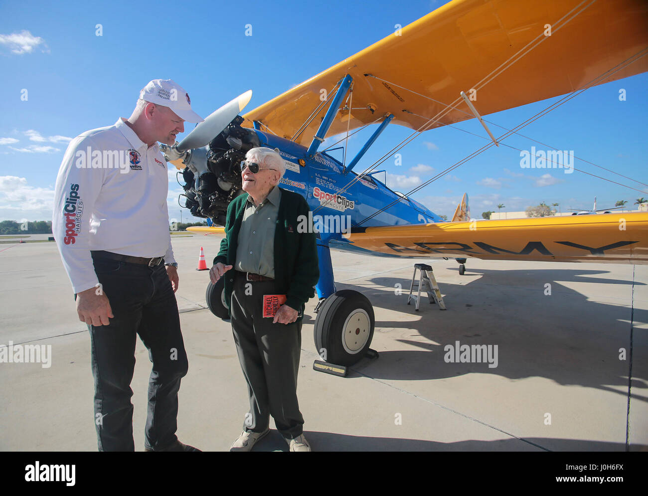 Florida, USA. 13th Apr, 2017. Duane Webster, age 95, talks with Darryl Fisher (Founder - President - Pilot of Ageless Stock Photo