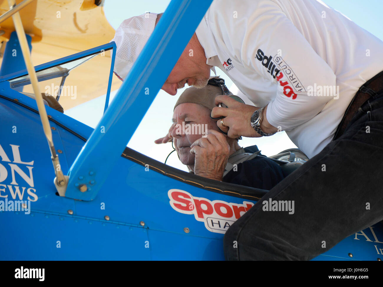 Florida, USA. 13th Apr, 2017. Bob Breiling, age 88, gets settled in the cockpit of a WWII-era biplane with help Stock Photo