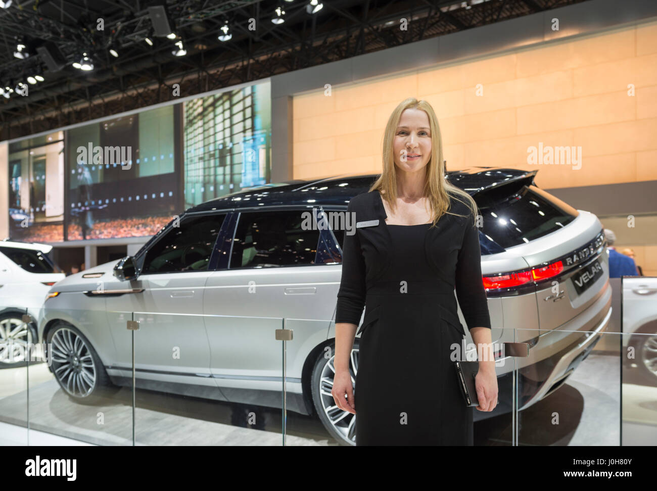 Manhattan, New York, USA. April 12, 2017. Female rep stands in front of Land Rover 2018 Range Rover VELAR, medium Stock Photo