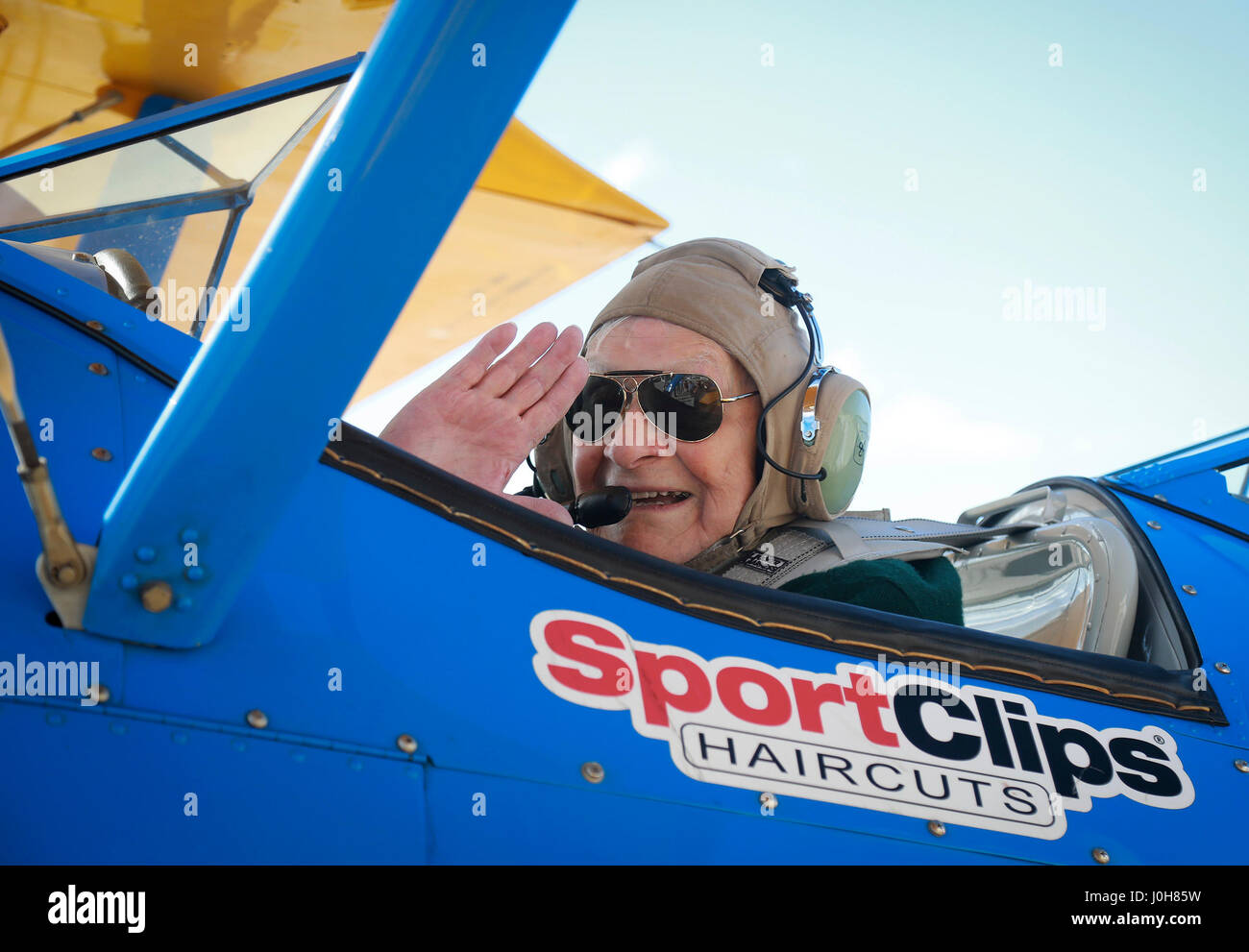 Boca Raton, Florida, USA. 13th Apr, 2017. DUANE WEBSTER, age 95, waves from the open-air cockpit of a WWII-era biplane Stock Photo