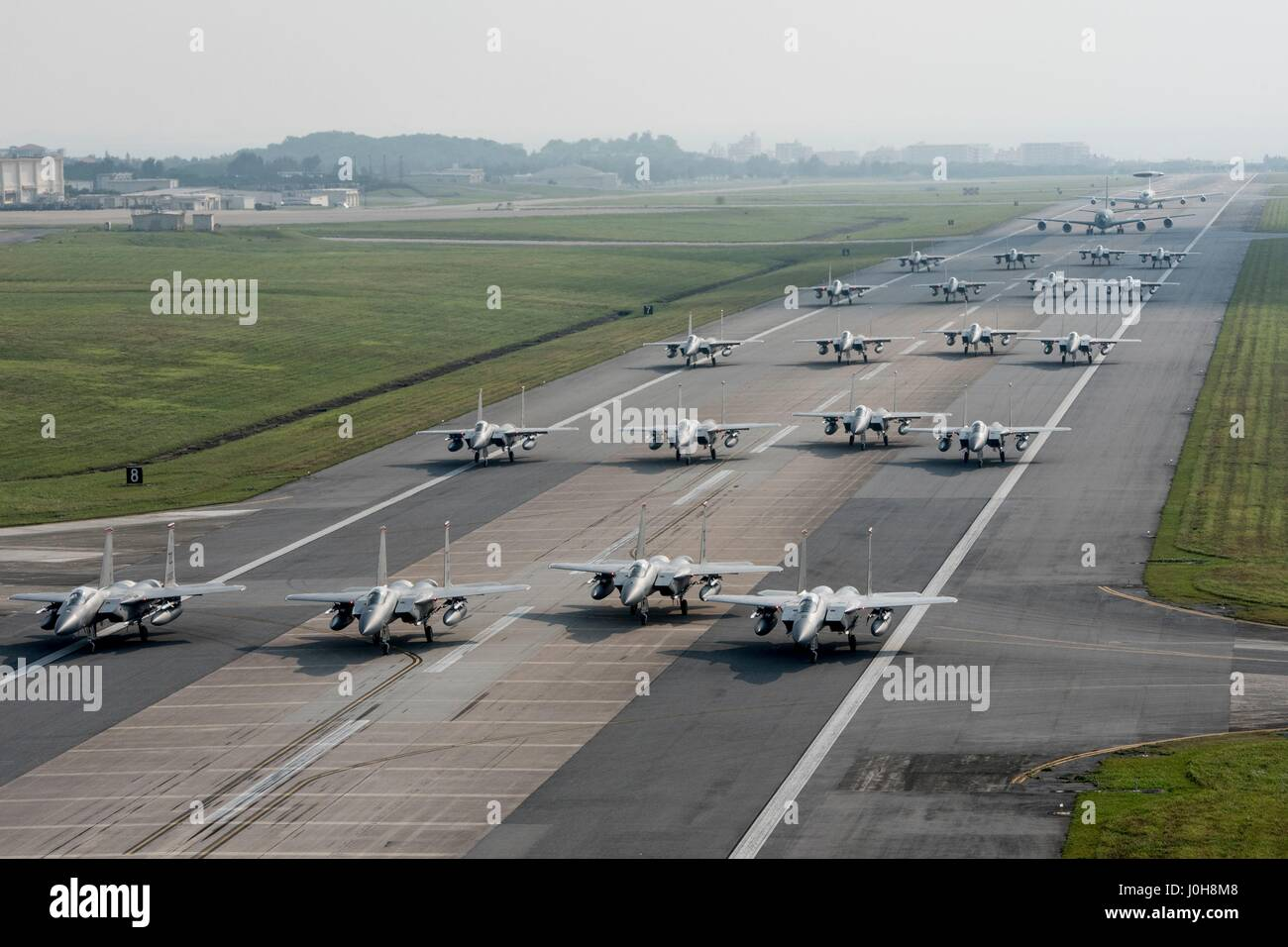 U.S. Air Force 44th and 67th Fighter Squadron F-15 Eagles taxi down the runway in an elephant walk during a no-notice - Stock Image