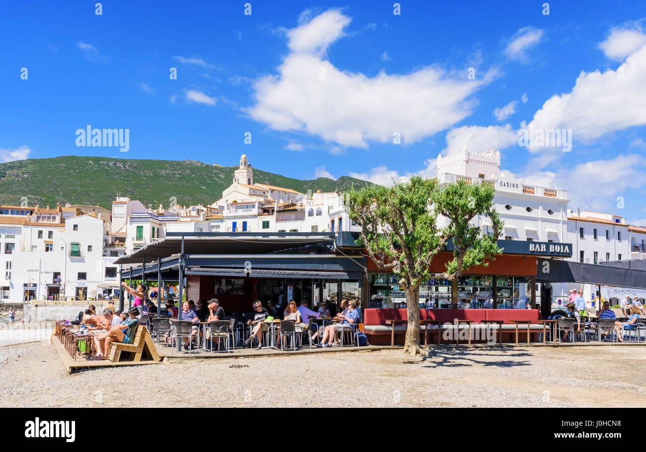 Busy beach bar on Cadaques Town main beach, Cadaques, Catalonia, Spain - Stock Image