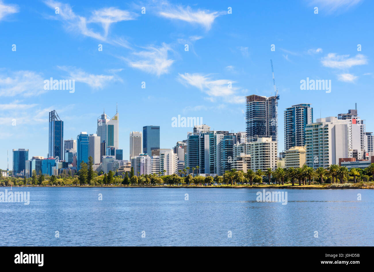 Perth city skyline views across the Swan River foreshore, Perth, Western Australia - Stock Image