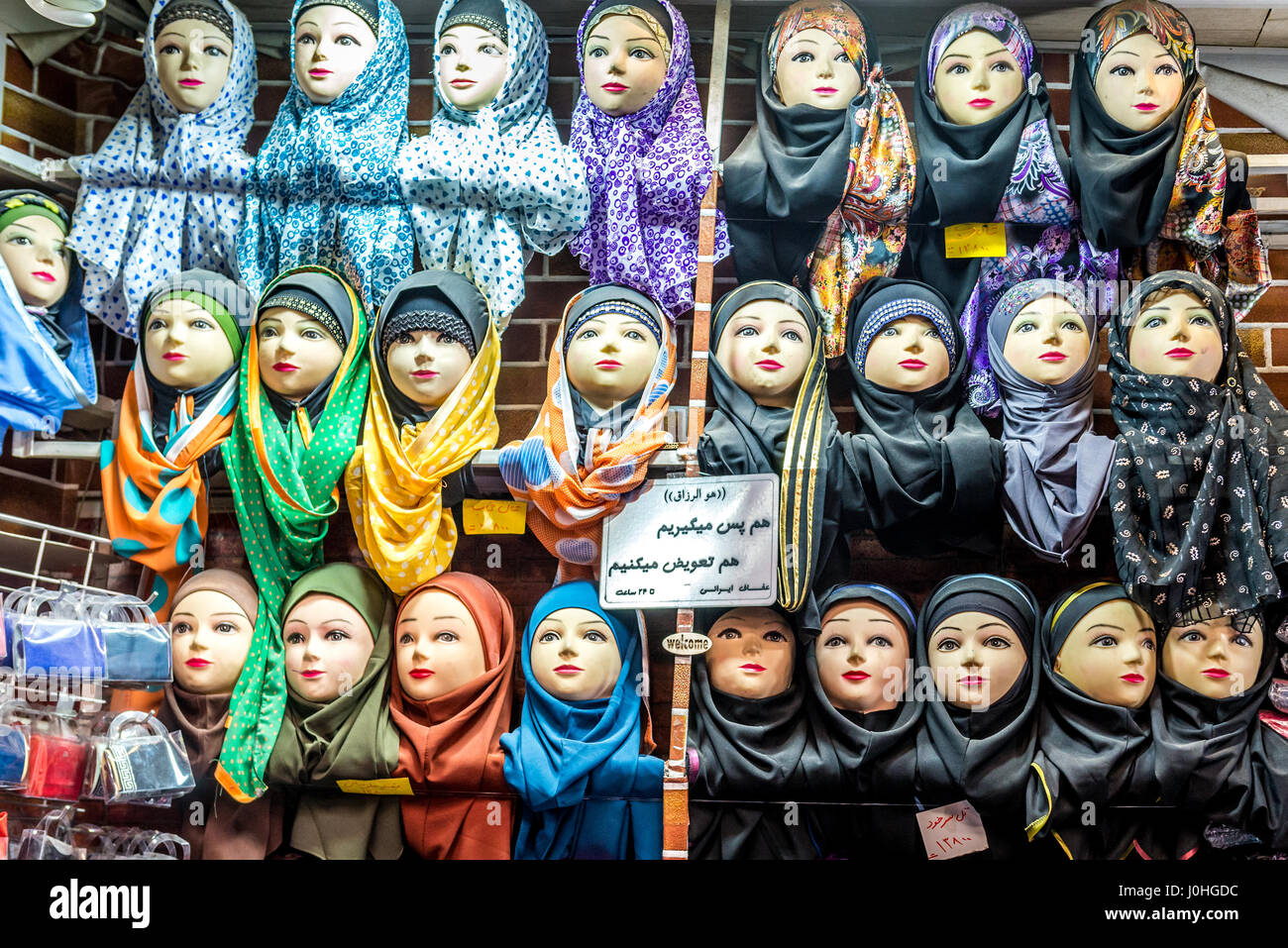Hijabs for sale in clothes shop in Shiraz city, capital of Fars Province in Iran - Stock Image