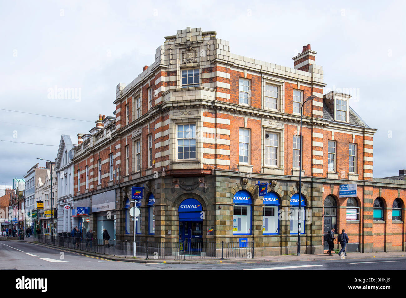 Former bank building now Coral Betting shop in Crewe Cheshire UK - Stock Image