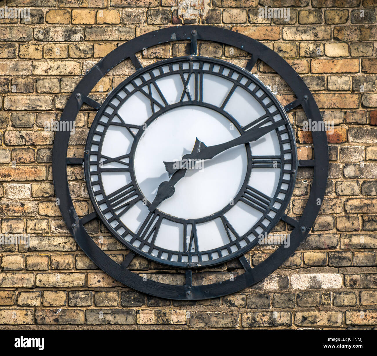 Zoomed view of large ornate Victorian clock, Leith Ports Office, Leith Docks, Edinburgh, Scotland, UK, showing 7.10 - Stock Image