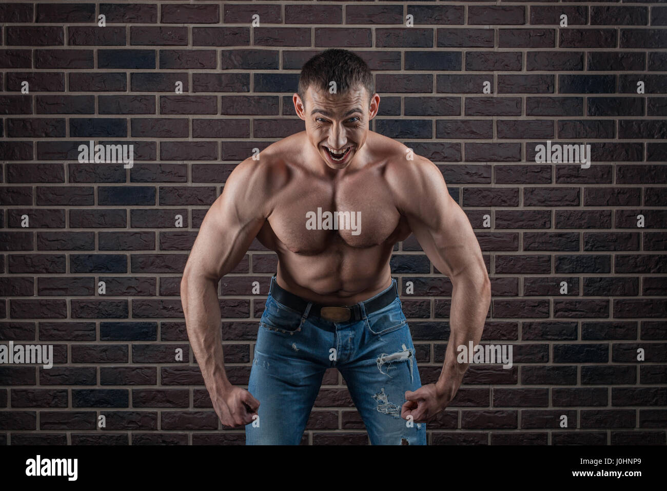 Bodybuilder threatening growls much straining your muscles. - Stock Image