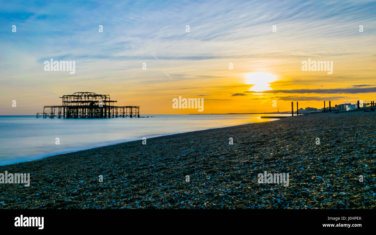 brighton beach at sunset - Stock Image