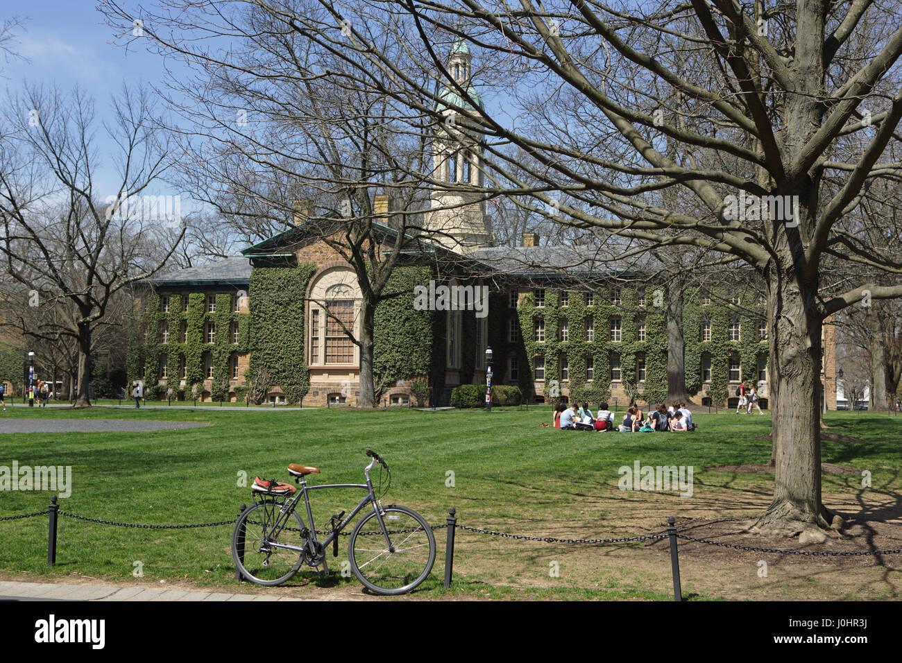 Princeton, NJ, USA - April 11, 2017: Princeton University Campus in spring. Nassau Hall and Cannon Green. Students - Stock Image