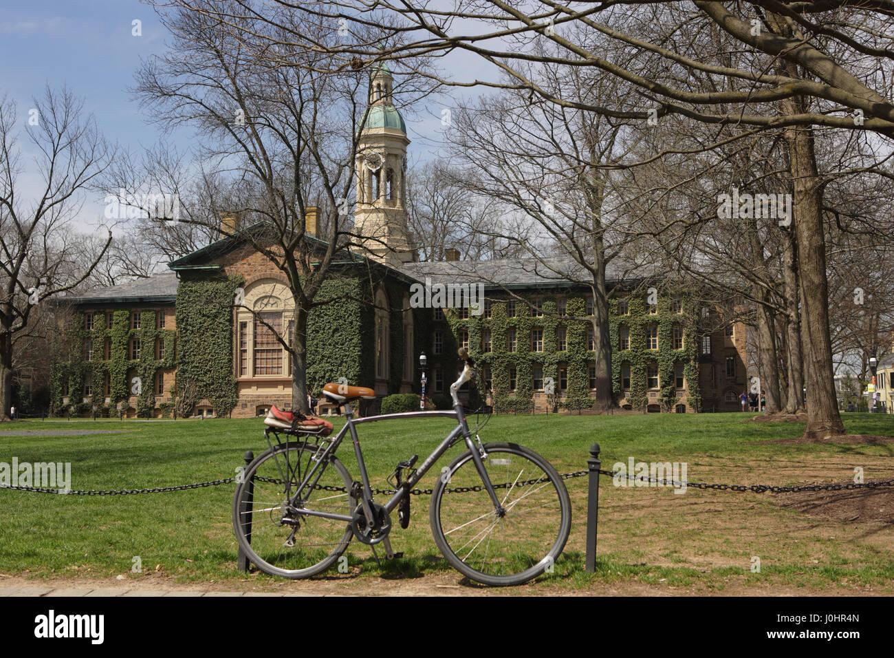 Princeton, NJ, USA - April 11, 2017: Princeton University Campus in spring. Nassau Hall and Cannon Green. Bicycle - Stock Image