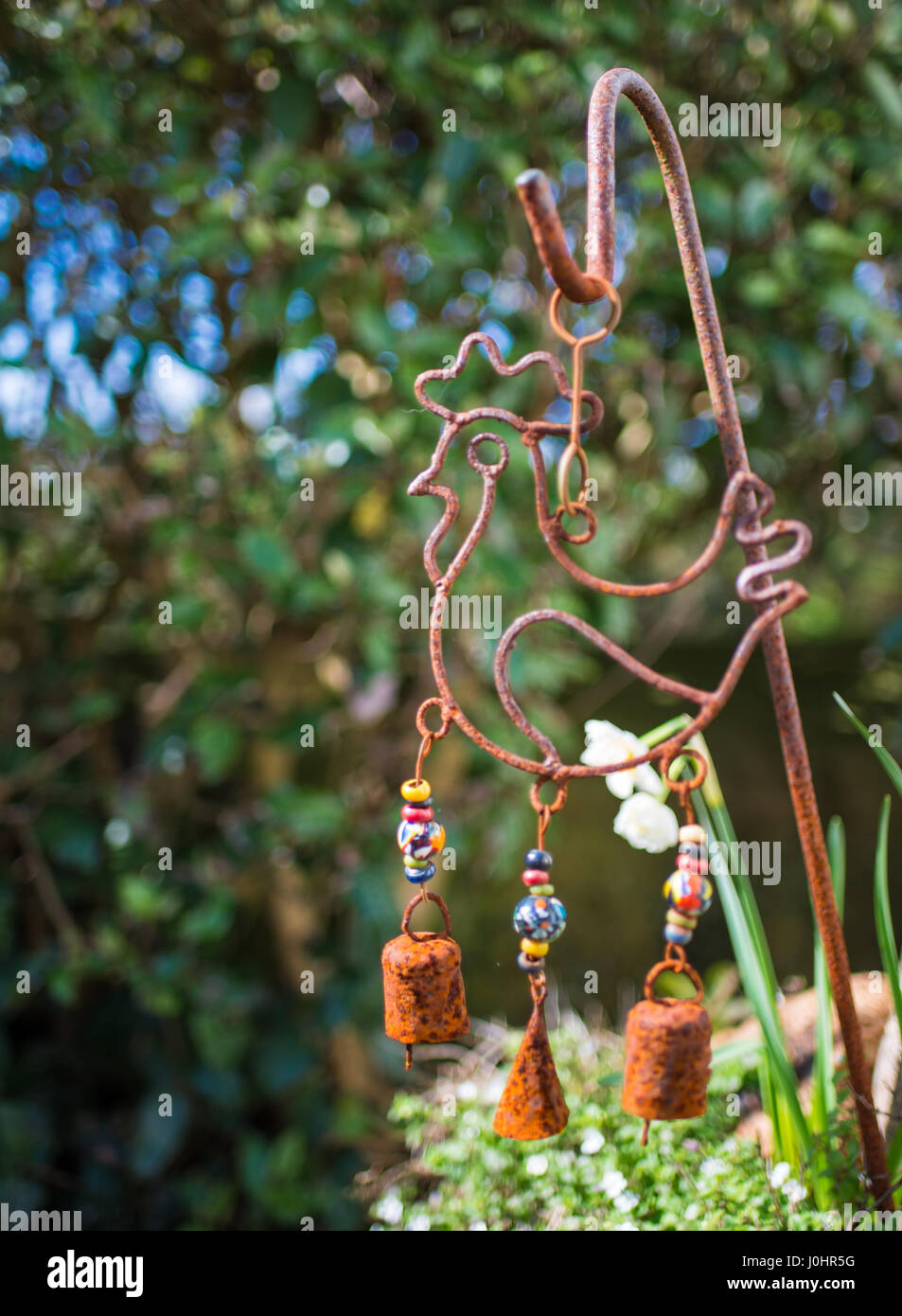 Chicken shaped wind-chime garden ornament - Stock Image