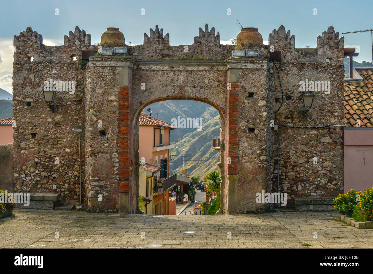 The old church wall in the medieval fortified town of Forza d Agro in Sicily 4a81b4e970bfa